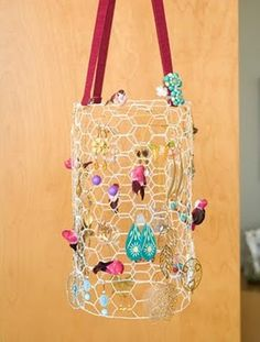 Upcycled chicken wire refashioned in to a fab jewellery organiser!    Source: Just Flew The Coop: Tackle The Mess: DIY Jewelry Organization