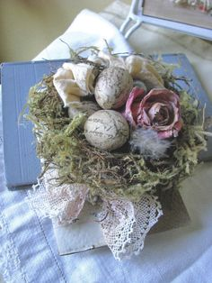 Nest with French tissue eggs and paper flower.