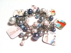 I think this might be a great anniversary gift. I would love it and my husband gets off cheap! Jane Austen Novels Charm Bracelet / Jane by RareJewelByKathy, $30.00