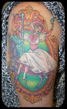 Mary Poppins on a carousel horse tattoo by Eddy-Lou (not sure why I like this so much . . . haha)