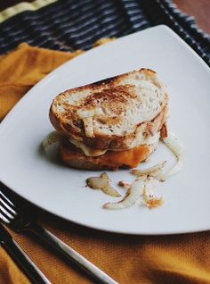 Grilled french onions, grilled cheddar and havarti cheeses, with a hidden poached egg. by the delectable @Oldbrandnew