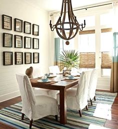 gallery wall with shell art in dining room, beautiful neutral coastal beach dining room