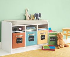 Personalize your household storage containers with chalkboard labels. Just write, erase, and write again. They peel off cleanly, too. #MarthaStewartHomeOffice #organization #storage #playroom