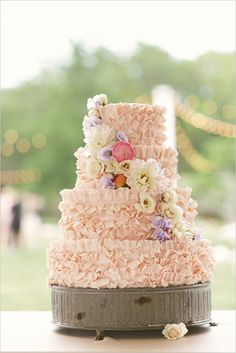 Pink ruffled wedding cake. Cake Design: Walton's Fancy and Staple ---> http://www.weddingchicks.com/2014/05/29/vintage-reception-with-steal-worthy-ideas/