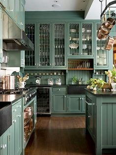 painted kitchen cabinets, lovely color, also beautiful glass inserts