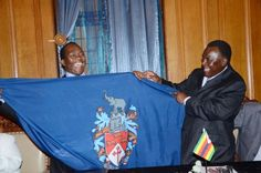 Durban Mayor, James Nxumalo, (left) and Mayor of Bulawayo in Zimbabwe, Thaba Moyo, strengthen relations by signing a Memorandum of Understanding. (October 2011).   Picture: presentation of Bulawayo coat of arms.
