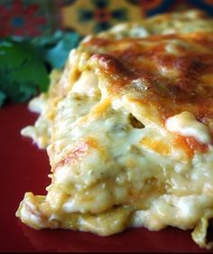 Creamy chicken enchiladas made into a Mexican lasagna.