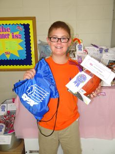 One happy Box Tops CAD raffle winner!  Our local Catholic High School gave us a football signed by the Varsity and Jr. Varsity players along with a Tee Shirt, Book Bag and passes to any PIUS event!  I have one happy 7th grader!