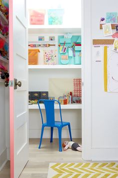 """a hidden closet """"office"""" in a kid's room, stocked with craft supplies"""