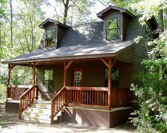 This is a nice size porch; would be perfect for the S.L. cabin facing circle drive.....   TUFF SHED cabin gambrel roof