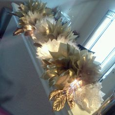 Tulle & tissue paper garland. I just used a dollar store strand of 20-bulb indoor  Christmas lights which was the perfect length! I tied each flower to the light strand with dollar store ornament hooks.