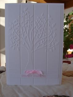 Don't have this tree embossing folder but like this white on white card front.