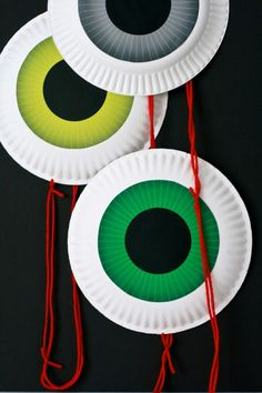 Make a super-easy eyeball garland (with red string for even more ick factor). #DIY #halloween