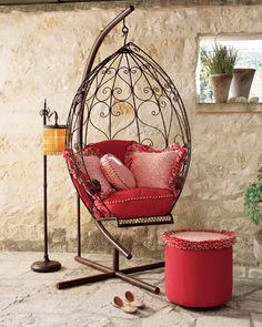 hanging bird cage chair with pink cushions & matching ottoman