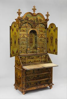 Pine secretary desk with carved, painted, gilded and varnished linden wood, decorated with colored decoupage prints, and a pane of mirror glass on each door [Italian], c. 1730–35