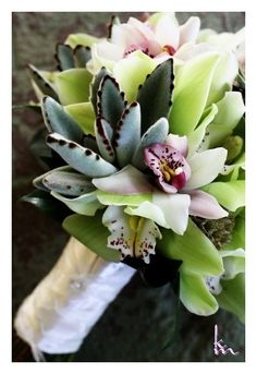 succulent bouquet with orchid using the succulent panda kalanchoe