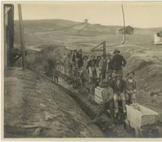 """Photograph of the """"North Port Crew,"""" workmen digging a tunnel for construction of the Los Angeles Aqueduct, ca. 1908. Catherine Mulholland Collection. San Fernando Valley History Digital Library."""