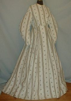 "1860's cotton brown on white maternity dress by pseitas, via Flickr. 1860s cotton print maternity dress. Fabric has a brown printed pattern on white background that has tiny brown dots. Neck, armscyes and waist are piped. Bodice lined with cotton and has front button closure. Skirt unlined. Bust: 38""; Waist: 34""; Skirt length: 42"". [Why maternity? Is this a dress remade into a wrapper? No construction details provided.]"