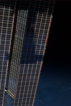 Casting shadows. The Russian Progress cargo vehicle on #ISS solar arrays at dusk. Taken November 1, 2013.  KN from space.
