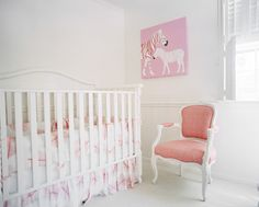 Kids' Room - A nursery with a pink upholstered chair and a white crib