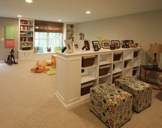 Basement playroom with trim and storage areas