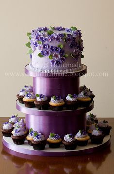 purple flower bridal shower cake and cupcakes