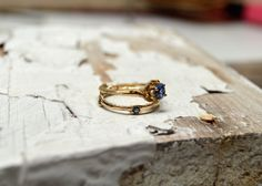 A delicate solid 14kt gold twig encircling a brilliant blue sapphire.