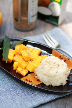 """Mango Sticky Rice: Mango sticky rice is a popular dish in the Indochina region (or in French """"Indochine"""") of Southeast Asia, in countries such as Thailand, Laos, Cambodia, and Vietnam. It's precisely a dessert dish where sticky rice is cooked by steaming, and sweetened with coconut milk and sugar. The sticky rice is then served with freshly cut mango cubes. It's such a great delight!"""