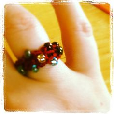 Ring with beads.