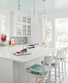 Loving the pops of color in this white and bright Lake Michigan beachfront cottage! And how amazing are those pendant lights?