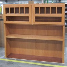 Custom bookcase cabinet with doors at the top. Glass will be installed in the doors later to hide office supplies.