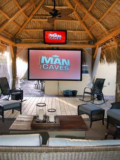 Chillaxation Man Caves : Home Improvement : DIY Network - outdoor man cave includes bar b que kitchen/grill not seen in the photo  http://www.diynetwork.com/home-improvement/chillaxation-man-caves/pictures/page-4.html