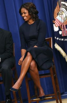 First Lady Obama in a navy dress with clean lines, cropped sleeves, & coordinating pumps (2014)