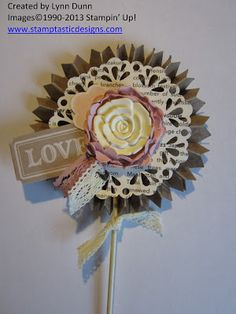"""♥♥♥ this """"Love Rosette"""" by Lynn Dunn.  Features products from the beautiful """"Artisan Embellishment Kit"""", available from Stampin' Up!  Take note of the decorated """"newspaper"""" doily and artisan embellishments.  In Lynn's own words ... """"Voila`!! Beautious!"""" and I agree!"""