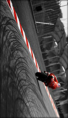 Super cool tilted photo of one of the best MotoGP riders ever, Casey Stoner.