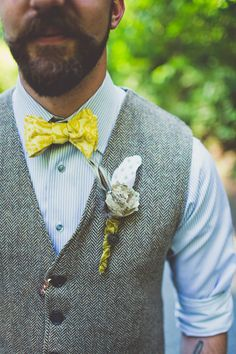 paper flower + feather boutonniere, photo by Sarah Kathleen http://ruffledblog.com/woodsy-wedding-with-paper-bouquets #grooms #boutonnieres