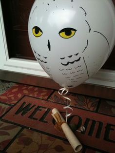 deliver party invites for a Harry Potter themed party by balloon owl