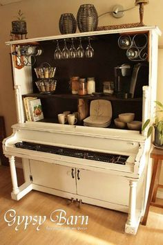 Repurposed Piano Pantry by Gypsy Barn... could make countertop with thick glass over keys...instead of just open cavity.