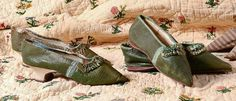 Very rare example of two pairs of  coordinated female shoes, Louis XVI, green morocco leather, both trimmed with blue ruched strap on the vamp, one with a heel sheathed in white leather, the other with a flat sole. Coutau-Bégarie