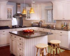 Love this colour scheme: white cabinets, beige backsplash, dark brown/gray countertop.