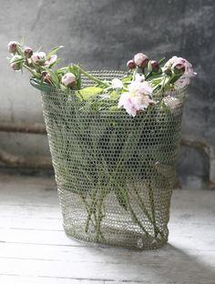 vintage metal basket full of pink blossoms