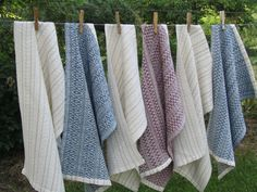 Linen towels woven in an 8 shaft twill threading from a 1912 Russian pattern book.