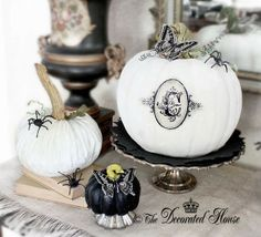 The Decorated House: ~ Halloween Decor - Pumpkins - Butterflies - Spiders! Oh Yes! Fun little projects for your Halloween Decor.  Paint a faux pumpkin white and add a Monogram of your choice. Make paper Butterflies. Create fun pumpkin stems and curly vines to add to your pumpkins.