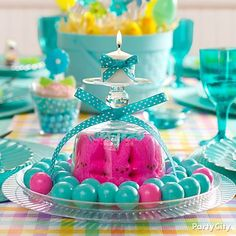 Upside-down glass candle holder + peeps = pretty Easter centerpiece idea. Click for more Easter decorations ideas!
