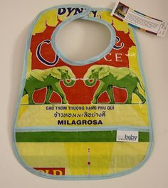 Bibs made by refugees out of recycled rice bags. Love the happy elephants.
