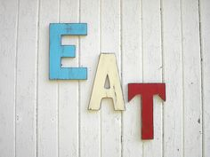 EAT Letters Sign Retro Americana Patriotic Red White Blue Wooden Kitchen Decor Word Art Wall Decor. $60.00, via Etsy.