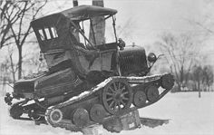Model T with snow tracks.