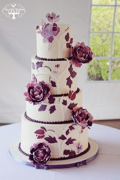 round tiered wedding cake with plum flowers and leaves - stunning!