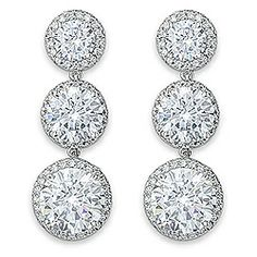 WOW!  Our Fantasia round drop earrings feature a 2.0 carat, a 4.0 carat and a 7.0 carat round cubic zirconia on each earring and are surrounded by a halo of pave set cz stones. Approximately 27.8 carats total weight, these earrings measure approximately 1 & 9/16 inches (46.0 mm) from top to bottom. Our price includes a pair of our large earring backs. These earrings are available in 14K white or yellow gold.