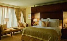 Mother-of-pearl panels behind bedside lamps create a soft glow in The Ritz-Carlton Suite at The Ritz-Carlton, Atlanta.